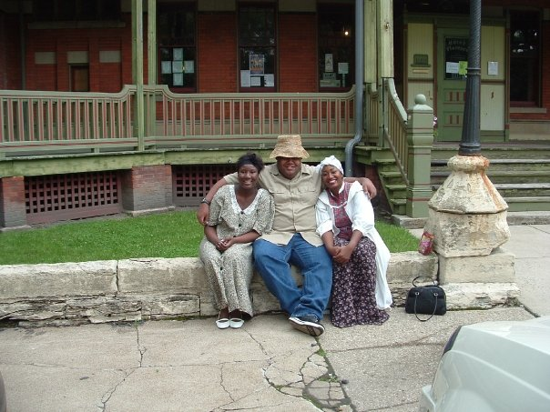 Joi Tucker Boose, Aaron Chandler, and Tiffancy Bruessard as presenters at Juneteenth Celebration 2011.  Photo on steps of Hotel Florence ~ Pullman State Historic Site